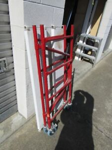 Barely used 4' rolling, folding scaffold w/ 6 decks!