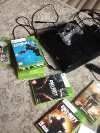 Xbox 360 elite 250gig with controller and 8 games