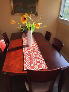 Solid wood dining table with 6 matching chairs