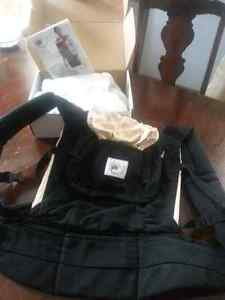 Ergo baby carrier and infant insert.