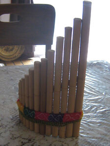 Carved wooden flutes, double flute and panflute
