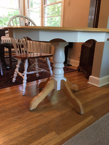 Round Wooden dining table set.