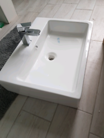 New white ceramic bathroom sink with waterfall tap