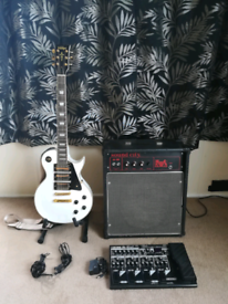 Les Paul electric guitar & Boss multi effects pedal and amp for sale.