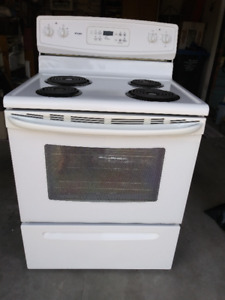 White KENMORE Electric 30 inch Range with 4 coil burners.