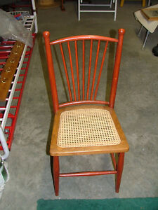 Wooden chair with cane seat
