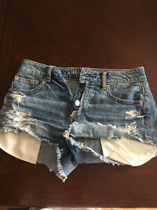 American Eagle high waisted medium wash jean shorts, size 0