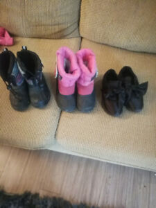 Girls 2 pair waterproof boots.  And a pair of links with sash.