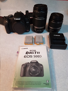 Canon Rebel T1i Camera c/w extra battery and telephoto lens