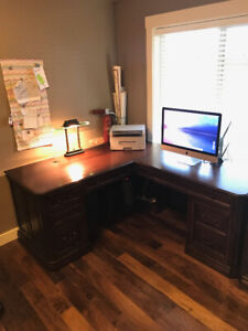 Office desk, file cabinets, and book shelf.