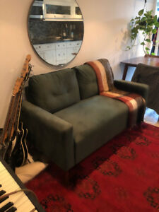 perfect forest green love seat with custom walnut legs