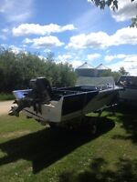 Older boat, trailer, motor, and spare tire for sale or trade.
