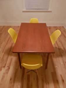Teak dining table and Eames chairs