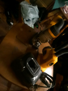 Dewalt cordless 18 volt jigsaw with charger and work light.