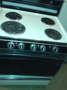 Beige Danby Stove - controls at front