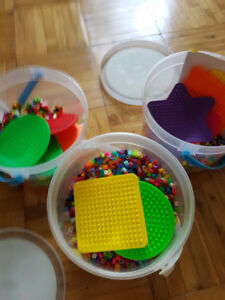 3 buckets of Fun Fusion Beads with peg boards