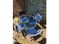 Round Glass Top Garden Table with 4 Folding Chairs