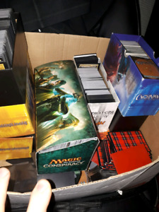 2 big boxes of magic cards.