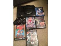 Sega Megadrive console with games sonic