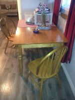 Looking to trade Big solid oak table for small round oak table