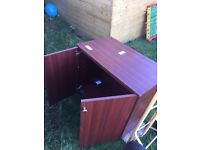 Free low cupboard with doors and shelf.