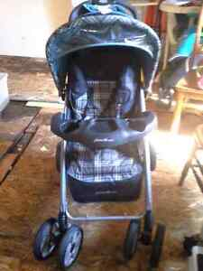 2strollers 1 eddie bauer and 1 evenflo