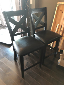 Two (2) brown counter chairs 43.5 x 18 x 17 in; 24 in floor-seat