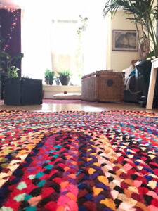 Colourful and bright braided area rug
