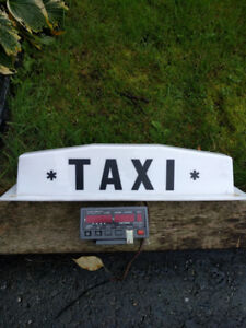 Taxi roof sign and long island meter