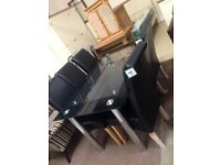 New black glass table £80 chairs £60 each