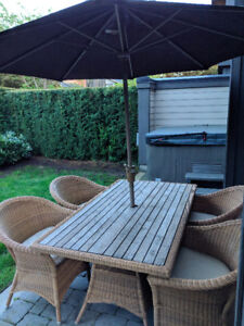 Outdoor teak patio dining table, 4 chairs, and umbrella