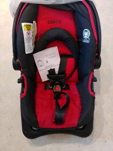 COSCO CAR SEAT ( NEW) NEVER USED STILL IN PLASTIC.