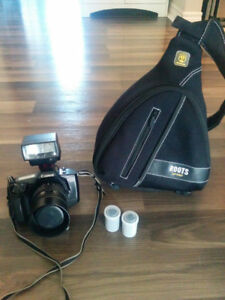 Canon EOS 650 SLR camera, Roots camera-case, flash and 3x film