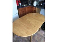 Extending wooden table and 4 chairs