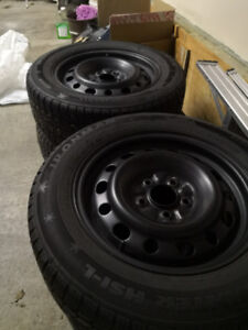 Winter Tires On Steel Rims 215/60/16- excellent condition