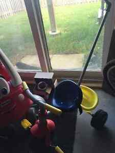 Almost brand new tricycle with basket and handle