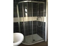 Corner shower tray and glass enclosure