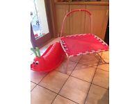 Kids pink trampoline and red caterpillar rocker seasaw