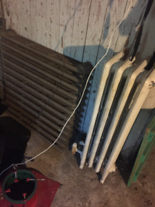 Two cast iron radiators 9 x 38 and 31 x 32.