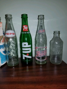 Vintage soda glass bottles: 7-Up and Pepsi