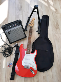 Red Elevation electric guitar, Gear 4 music amplifier, stand and bag