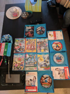Nintendo WiiU + Four Controllers, Fight Pad and 10 Games