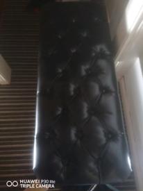 Long black footstool