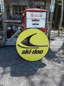 CLASSIC SKIDOO AND GASOLINE SIGNS
