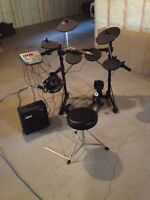 Electronic drum kit with amp, throne and headphones