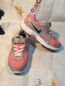 size 12 Pink / Grey Nike Runners