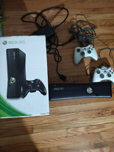 Black XBOX 360 with 2 controllers and lots of games!!!