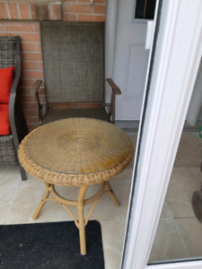 Table with glass top and two matching chairs for sell