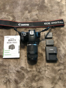 Canon Rebel T3 1100D with 2 lenses