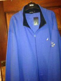 Men's new with tags Nautica half zipped top.